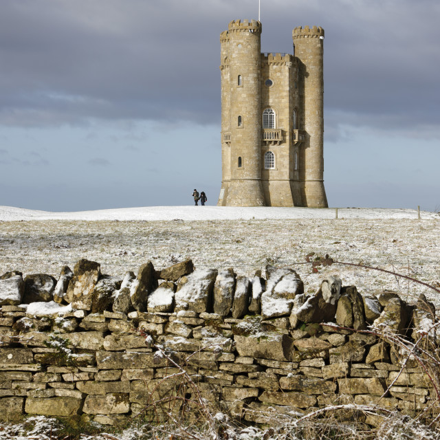 """Broadway Tower and cotswold drystone wall in snow, Broadway, Cotswolds,..."" stock image"