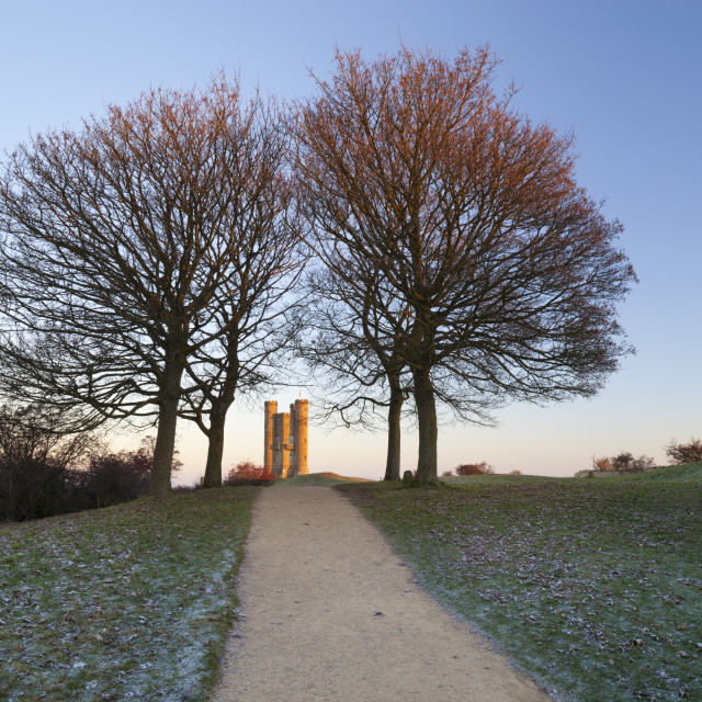 """Broadway Tower framed by trees in winter frost at sunrise, Broadway,..."" stock image"