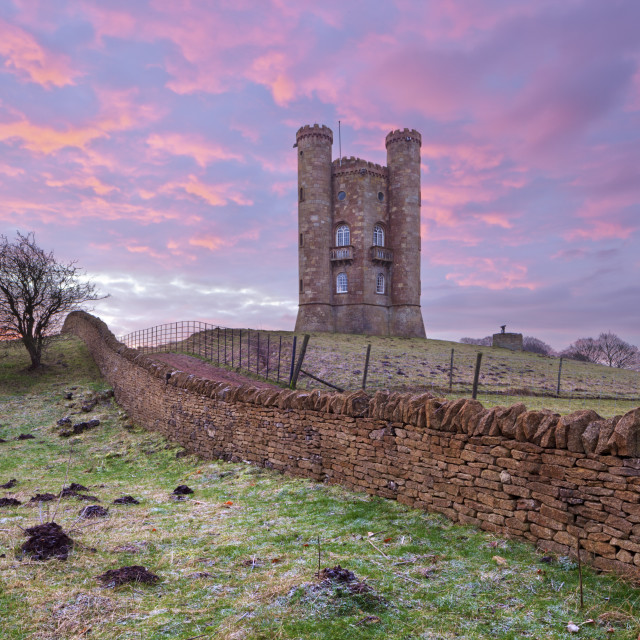 """Broadway Tower and cotswold drystone wall at sunrise, Broadway, Cotswolds,..."" stock image"