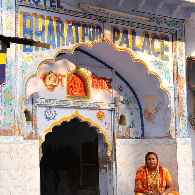 """Woman in front of an old temple transformed into an hotel, Pushkar,..."" stock image"
