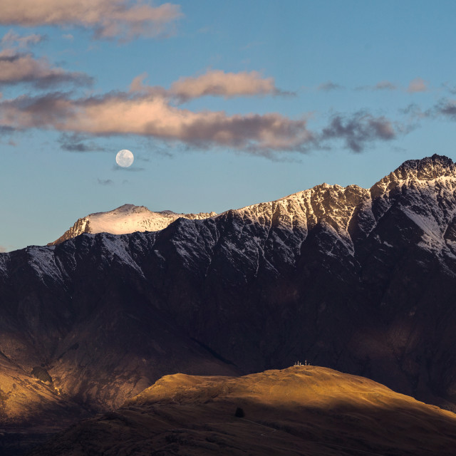 """Moon rises over The Remarkables Otago New Zealand"" stock image"