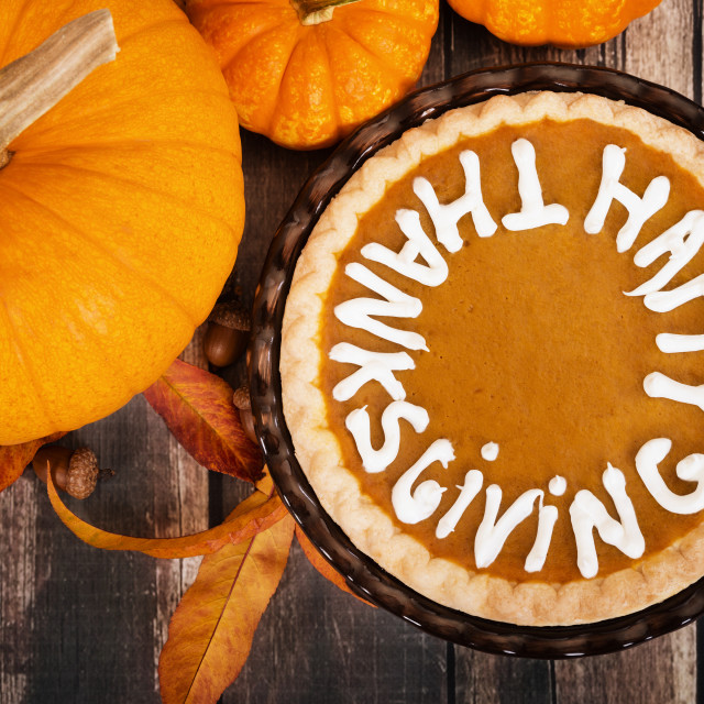 """Pumpkin pie with pumpkins and autumn decoration on vintage woode"" stock image"