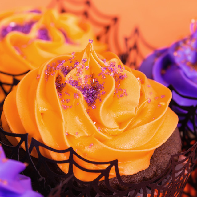 """Orange and purple Halloween cupcakes"" stock image"
