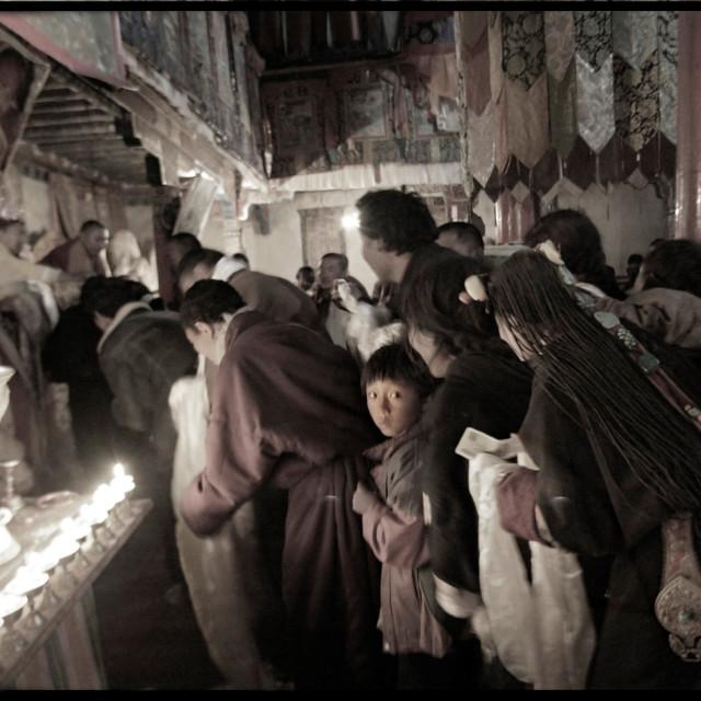"""Khampa nomads in prayer line in temple, Nangchen, Tibet"" stock image"