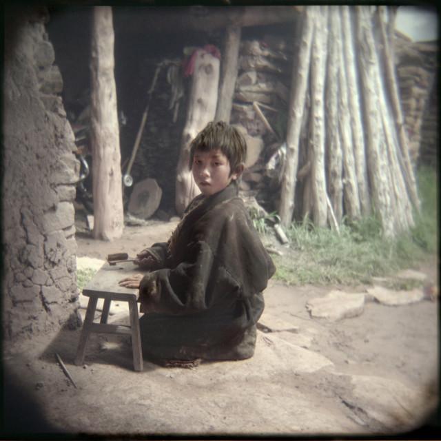 """""""Nomad boy playing, Nangchen, Tibet"""" stock image"""