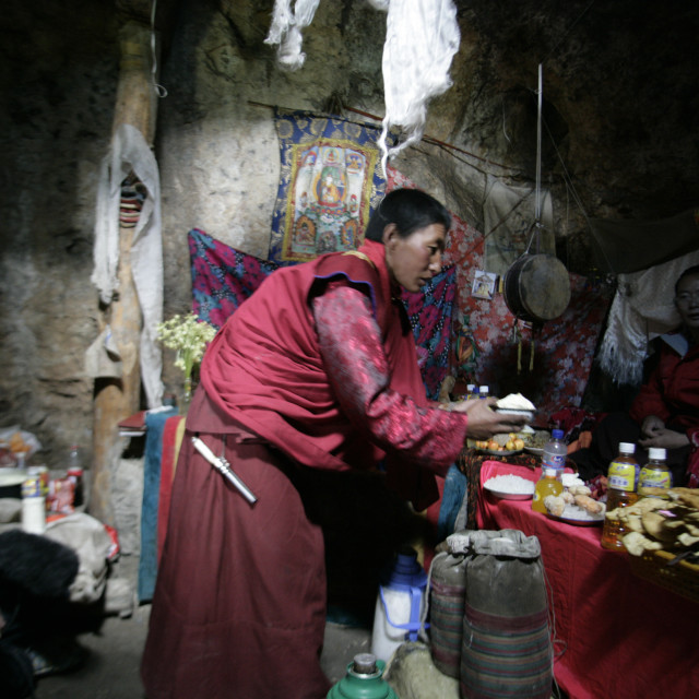 """Nun Serving Rice, Chari Gonpa, Nangchen, Tibet"" stock image"