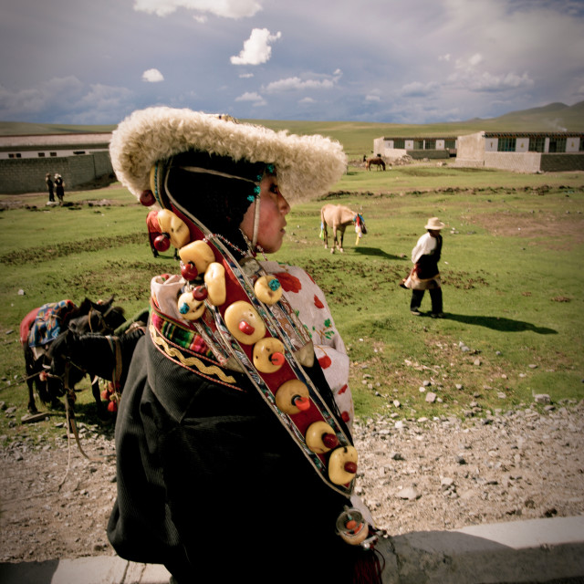 """Khampa woman in traditional clothing, Nangchen, Tibet"" stock image"