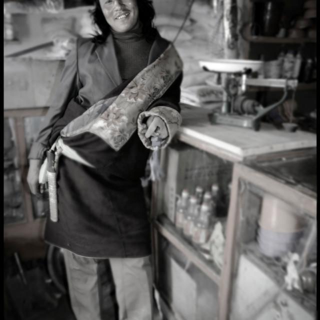 """Khampa man in store, Nangchen, Tibet"" stock image"