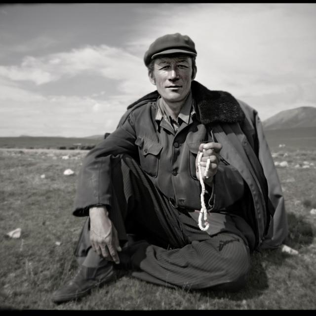 """Khampa man with mala, Nangchen, Tibet"" stock image"