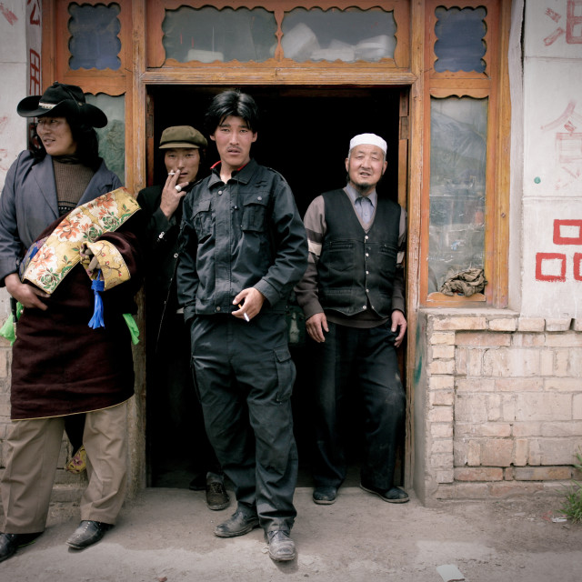 """Khampa Men outside store, Nangchen, Tibet"" stock image"