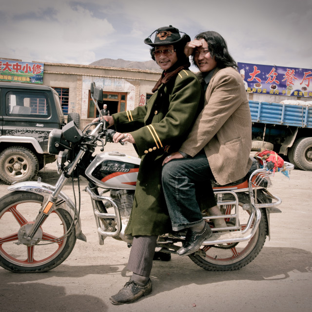 """Two khampa men on Motorcycle, Nangchen, Tibet"" stock image"