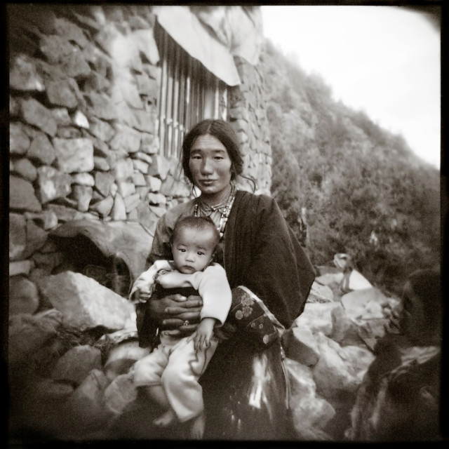 """Khampa mother and baby., Tibet"" stock image"