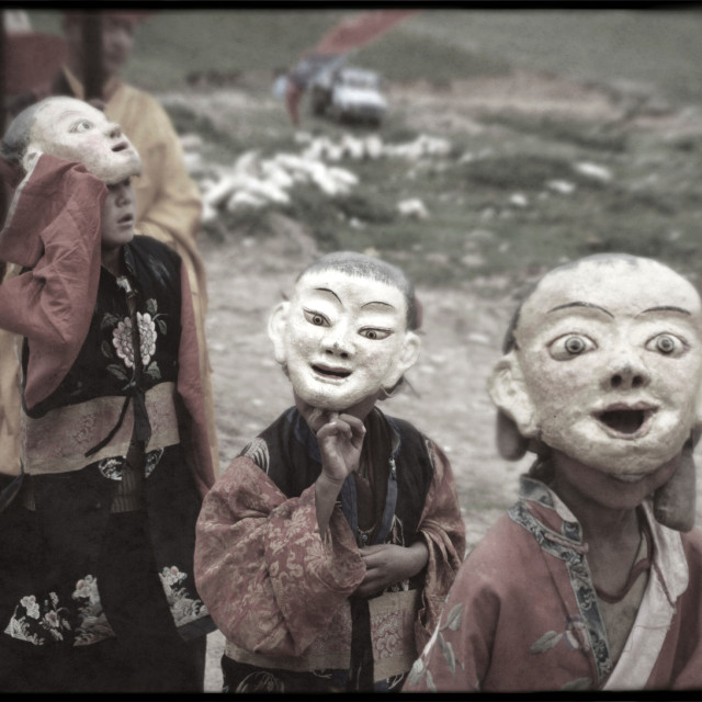 """Monks with masks, Kham, Tibet"" stock image"