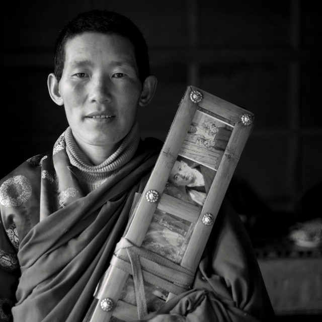 """Nun with text, Nngchen, Tibet"" stock image"