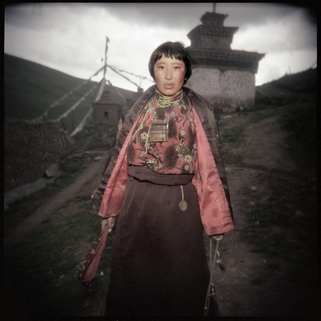 """Nun on path, twilight ,Dechen Ling Nangchen Tibet"" stock image"