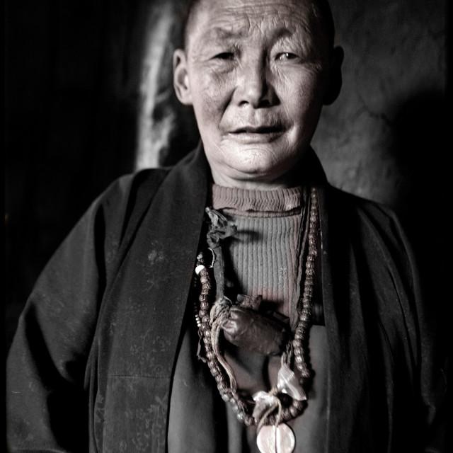 """Old nun, Dechen Ling Nunnery, Tibet"" stock image"