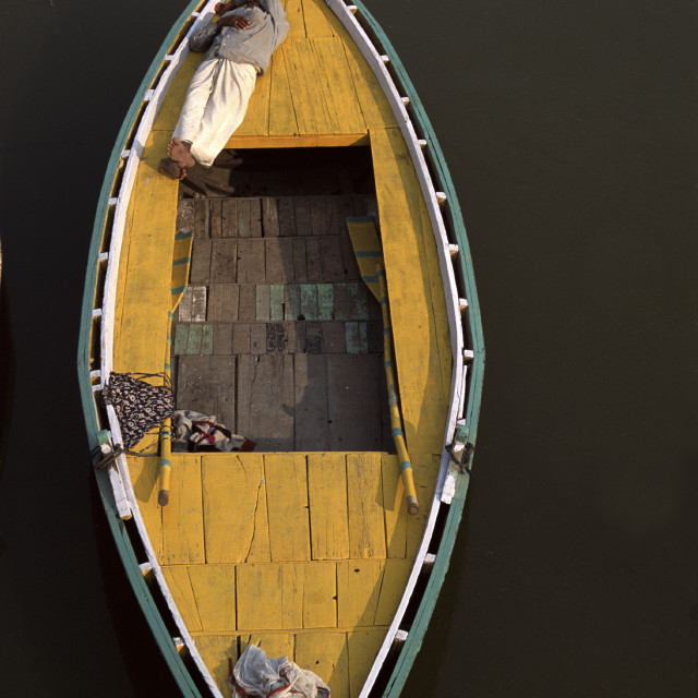 """yellow boat on Ganges, Varanasi, India"" stock image"