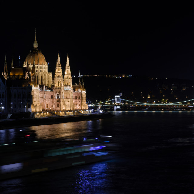 """Hungarian Parliament and the Danube river illuminated at night."" stock image"