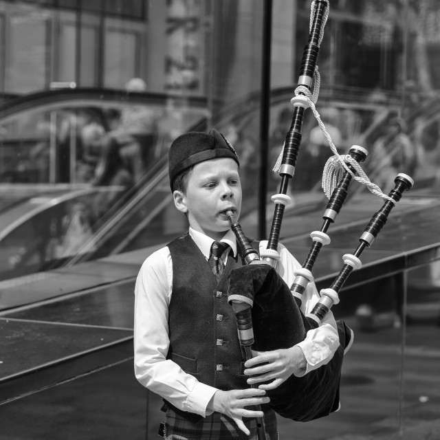 """Young Scottish Bagpiper"" stock image"