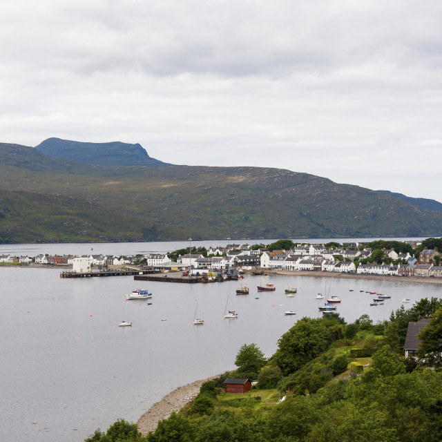 """Ullapool, Scotland - August 15, 2010: View of the fishing port and the village of Ullapool in the Highlands in Scotland, United Kingdom"" stock image"