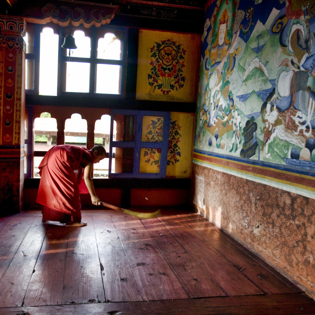 """""""Young monk sweeping in Monastery, BhutanYoung, Monk, sweeping, Mongar Dzong monastery, bhutan, buddhism, monastery, religion, asia, travel, buddhist, mountain, buddha, himalaya, bhutanese, temple, tourism, architecture, culture, holy, pilgrimage, building"""" stock image"""