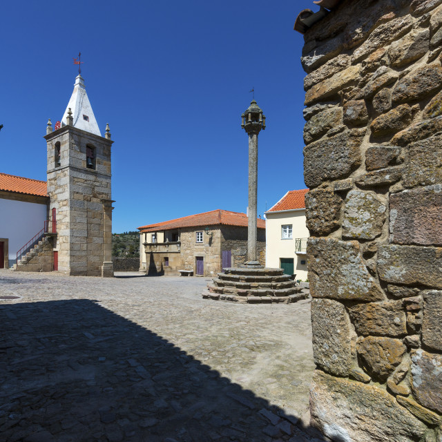 """View of the central square of the historic village of Castelo Mendo, in Portugal, with a church and pillory; Concept for travel in Portugal"" stock image"