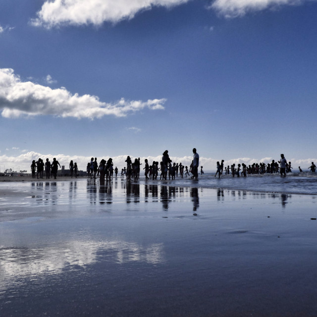 """Silhouettes of people on a summer morning on the beach"" stock image"