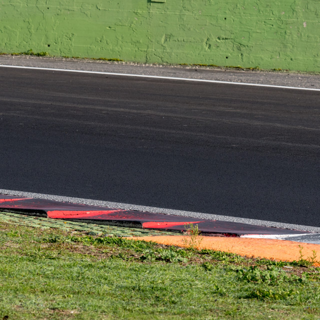 """Curb and turn detail on motor racing circuit"" stock image"