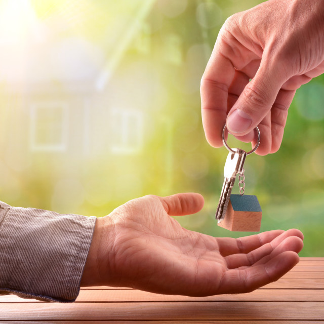 """""""Agent giving the keys to the buyer of a house"""" stock image"""