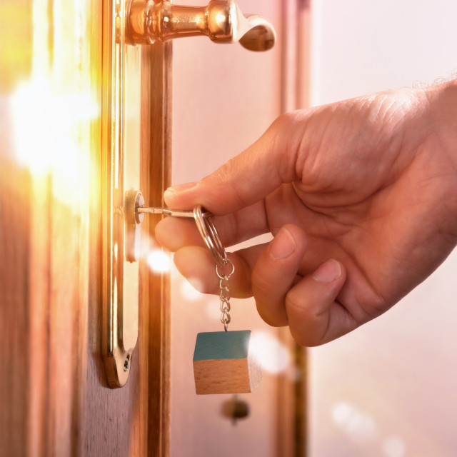"""""""Hand that locks the door with light effect"""" stock image"""