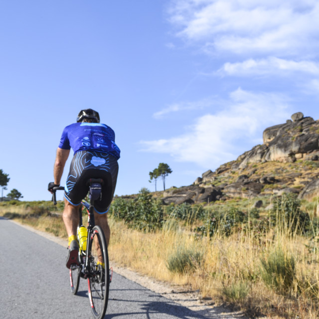"""Lone cyclist in Portugal"" stock image"