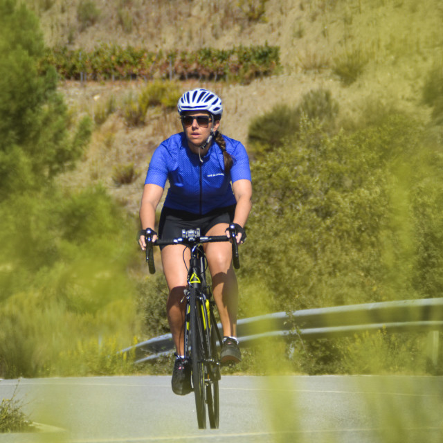 """Woman cyclist riding in Portugal"" stock image"