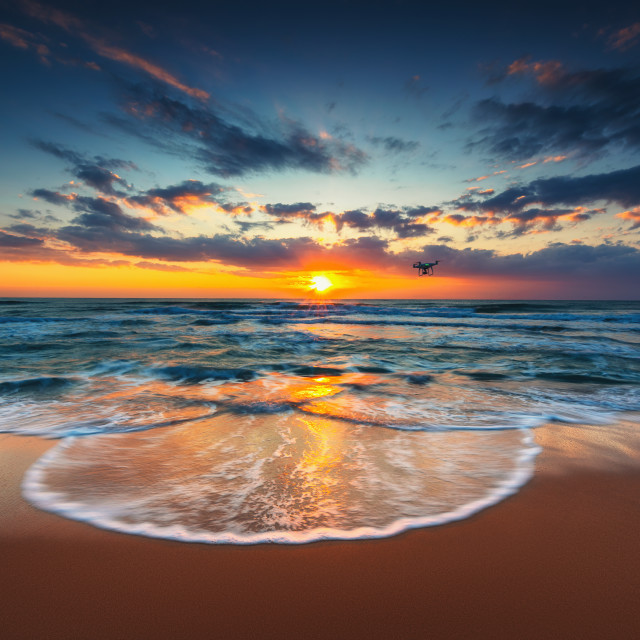 """""""Flying drone over the sea. Sunrise shot"""" stock image"""