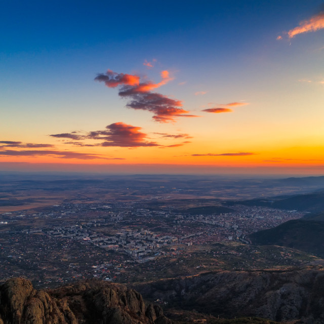 """""""Dramatic sunset over the mountain hills and Sliven city, aerial"""" stock image"""
