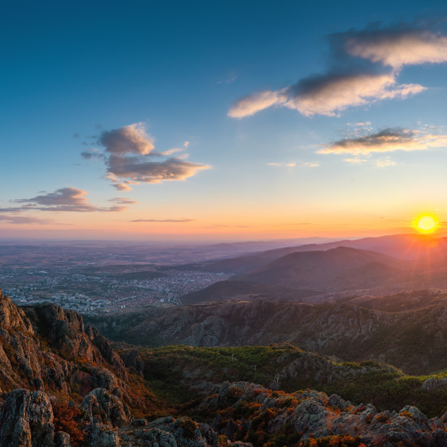 """""""Beautiful sunset over the mountain hills and city, aerial panora"""" stock image"""