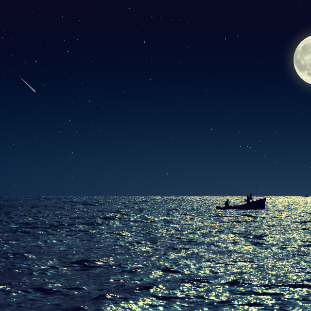"""""""Scenic view of small fishing boat in calm sea water at night and"""" stock image"""