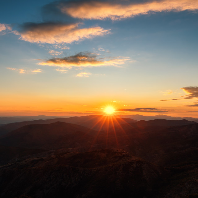 """""""Colorful sunset on top of mountain alps"""" stock image"""