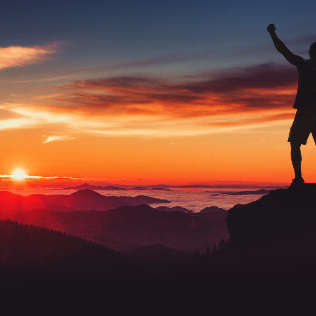 """Man silhouette on mountain cliff enjoy panaoramic view. Man watc"" stock image"