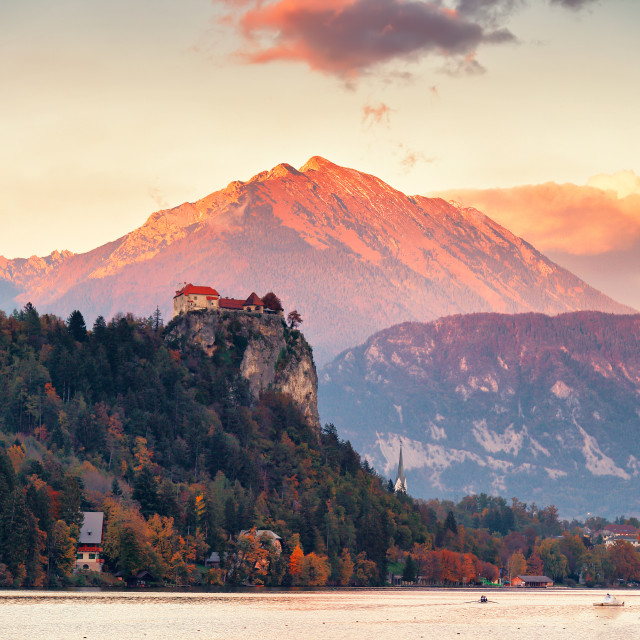 """Picturesque Slovenia, Bled lake and town at sunset."" stock image"