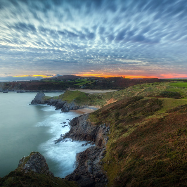 """Blue hour at Three Cliffs Bay"" stock image"