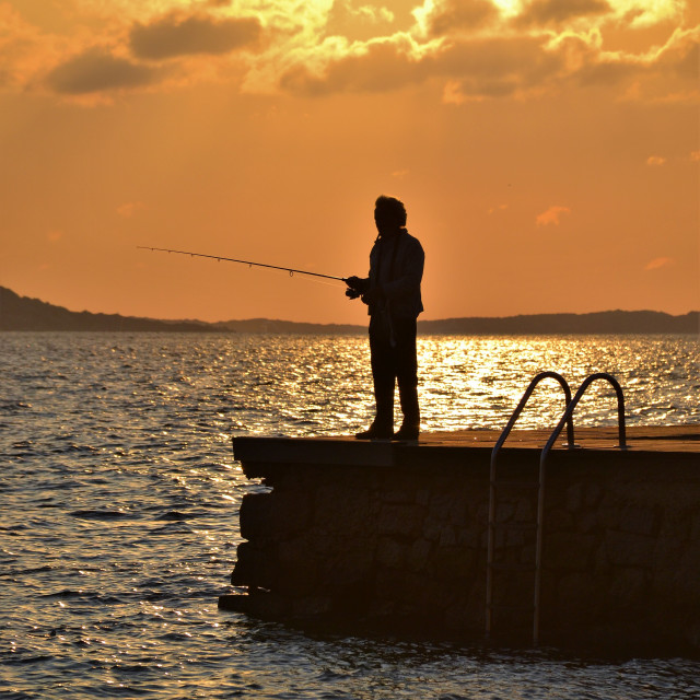 """Sunrise Fisherman"" stock image"