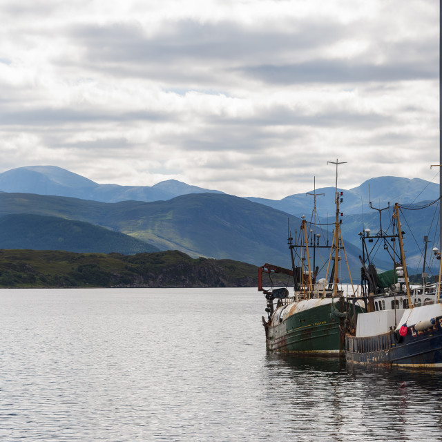 """Ullapool, Scotland - August 15, 2010: View of the fishing port of Ullapool in the Highlands in Scotland, United Kingdom"" stock image"