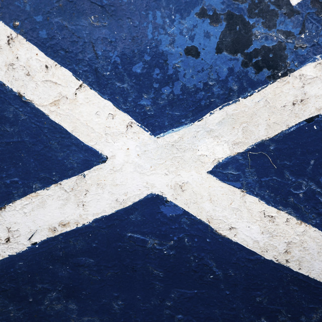 """The Flag of Scotland painted in the hull of a ship; Concept for travel in Scotland"" stock image"
