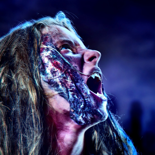 """""""Undead zombie scary girl on halloween graveyard at night."""" stock image"""