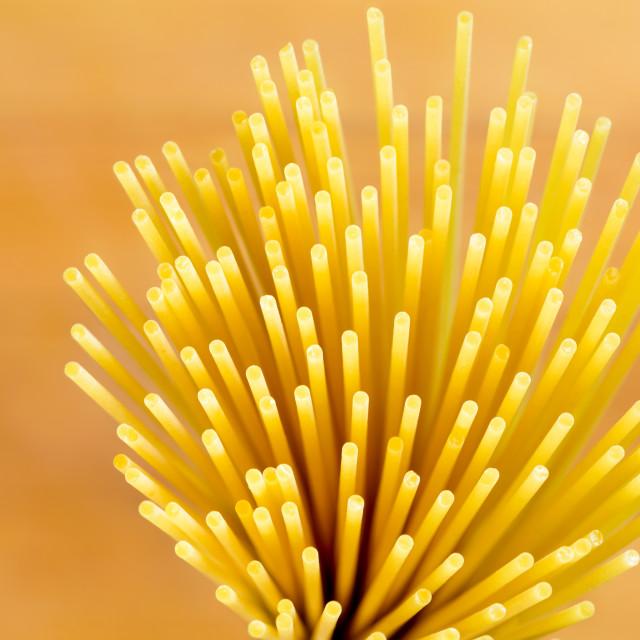 """Italian Spaghetti Extruded Through Bronze"" stock image"