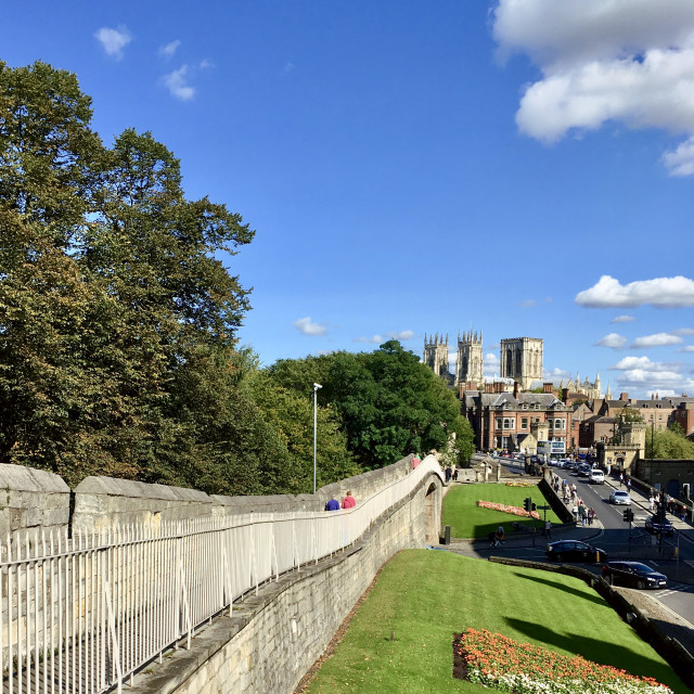 """Walking along the wall towards York Minister"" stock image"