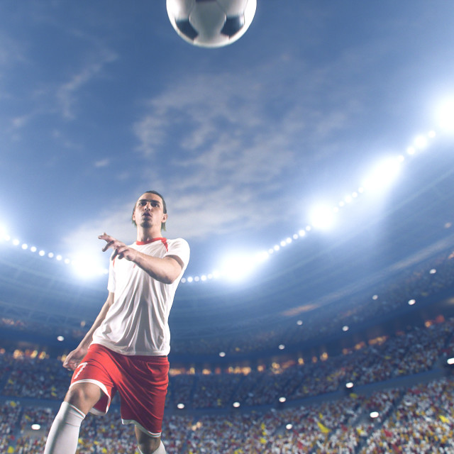 """Soccer player kicks the ball on the soccer stadium. He wear unbranded sports clothes. Stadium and crowd made in 3D."" stock image"
