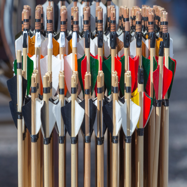 """Arrows - handmade with colorful headers on a stand for sale at medieval festival. Concept for historical recreation festivity and games"" stock image"