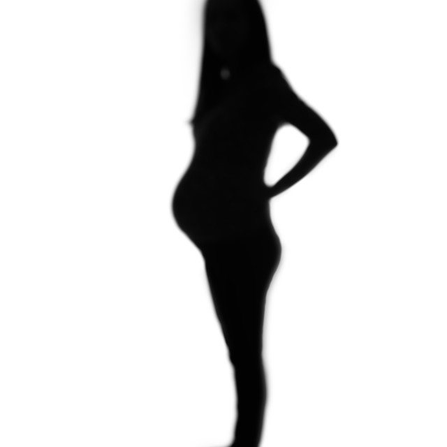 """""""Defocused silhouette of pregnant woman isolated on white"""" stock image"""