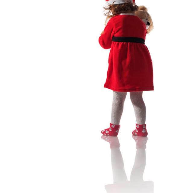 """Little girl in red santa hat on white background"" stock image"